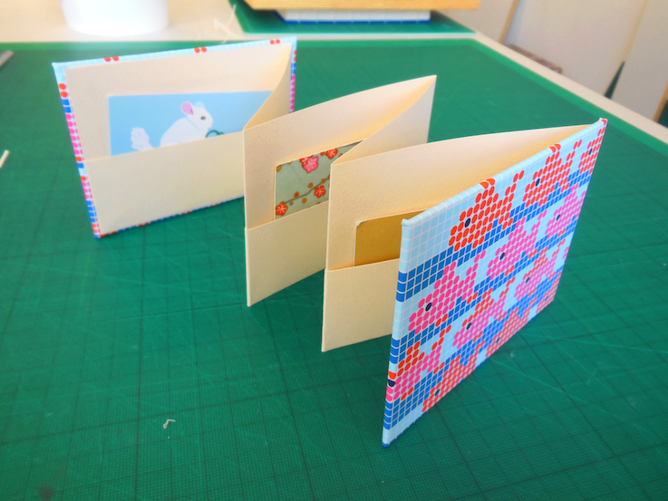 Accordion cardholder book.