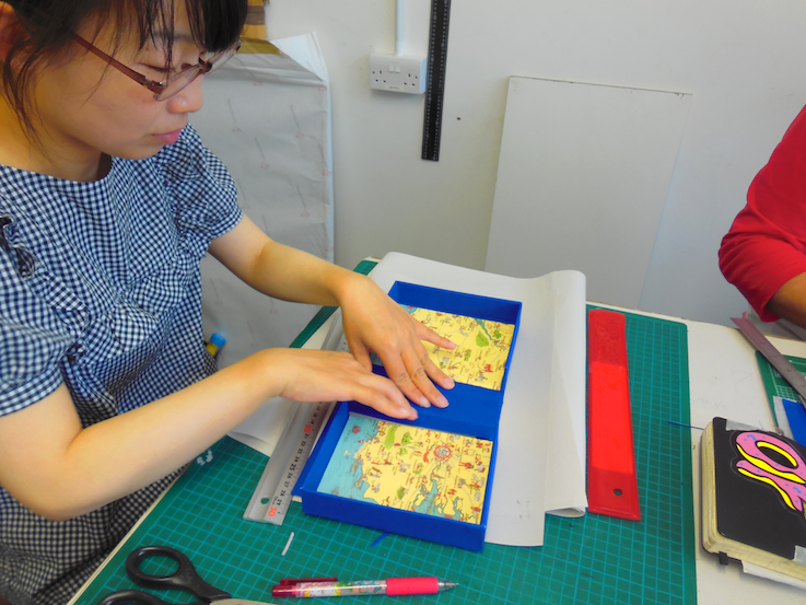 Yasuko lining her box.